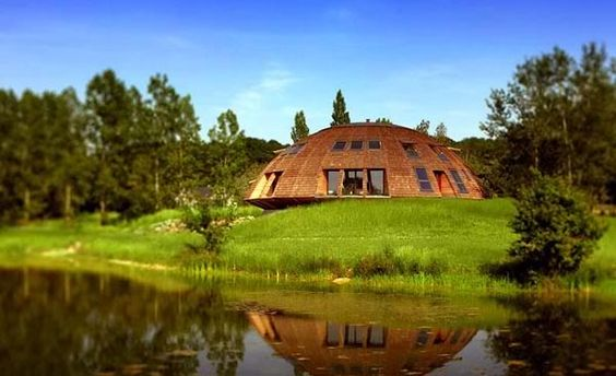 Domespace is a rotating wooden house. The design brings numerous benefits. For example, the shape makes it resistant to cyclonic winds and it was built over an elastomeric belt which cushions vibrations and this also allows the house to withstand earthquakes of up to 8 on the Richter scale. This UFO-like house also makes the most of passive solar energy and it can rotate to follow the sun.{found on gizmag}.