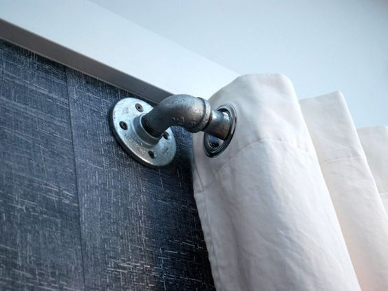 Plumbing fittings as curtain hardware.  How fitting!