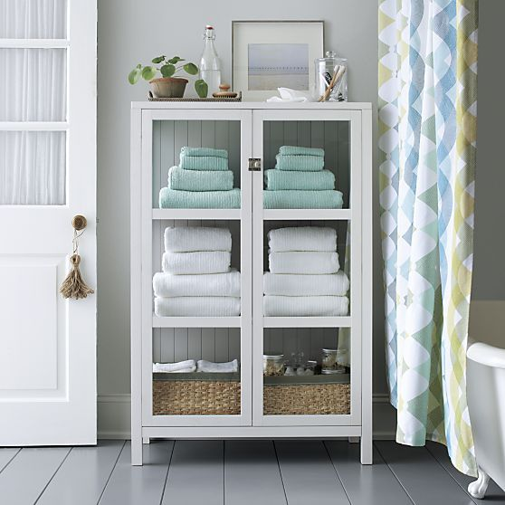 Clean lined classic cabinet frames books  linens  cookware and collectibles in white   middot  Bathroom. Kraal White Cabinet   Crate and Barrel   Daniel o  39 connell  Towels