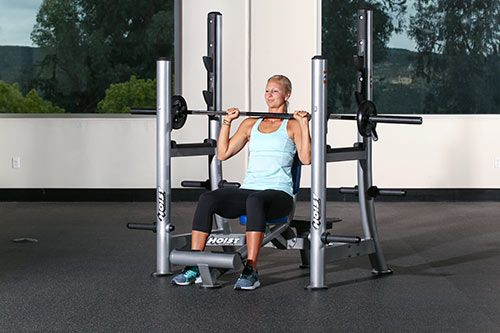 Sit In A Shoulder Press Bench And Rack And Keep The Back Straight While Gripping The Bar With The Shoulder Press Shoulder Press Workout Close Grip Bench Press