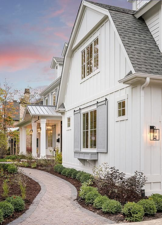 White Vertical Siding With Gray Shutters Combined Creates A Clean Fresh And Contemporary Farm Styl Modern Farmhouse Exterior Farmhouse Exterior House Exterior
