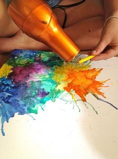 Melting crayons to create explosion effect.