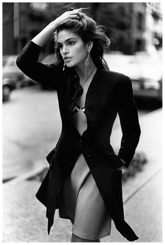 Cindy Crawford from the 90's, my sister & I would play with make-up...and always draw a little 'beauty mark' on ourselves because of hers! Ha!