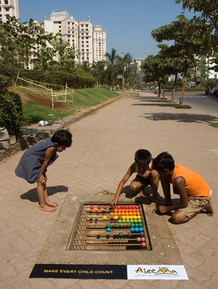"""Here's a great example of transforming the everyday environment into a powerful message, the storm drain abacus with the message """"Make every child count."""" Created for Aseema Charitable Trust, the goal was to promote the need for education for street children and it does so in a way that is striking and intuitive."""