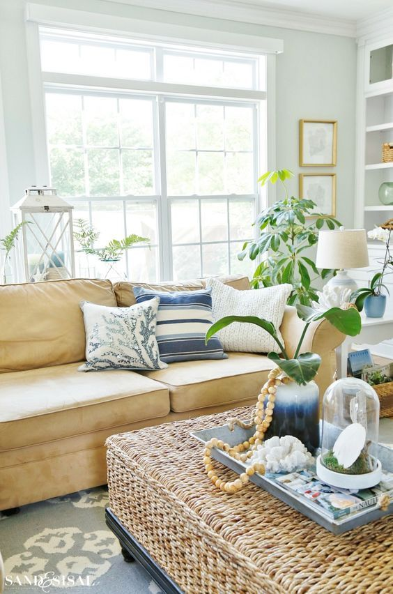 Modern Coastal Living Room In White Beige And Blue With A Large Sea Grass Woven Ottoman Cockta Coastal Family Rooms House Decor Modern Family Room Decorating