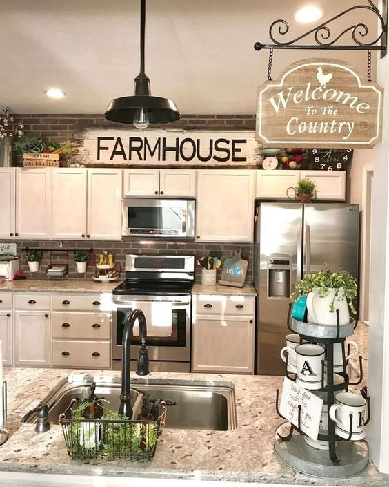 30 Farmhouse Kitchen Decor Ideas To Make Your Kitchen Look Warm Welcoming Hike N Dip Above Kitchen Cabinets Farmhouse Kitchen Decor Kitchen Cabinets Decor