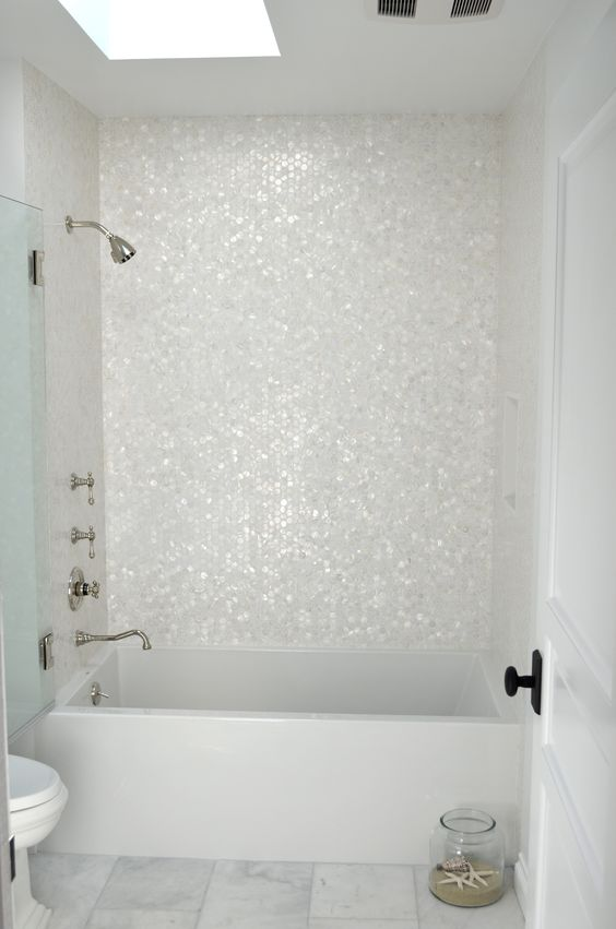 White Mother of Pearl Hexagons https://www.subwaytileoutlet.com/products/White-Hexagon-Pearl-Shell-Tile.html#.VOUCRfnF-1U
