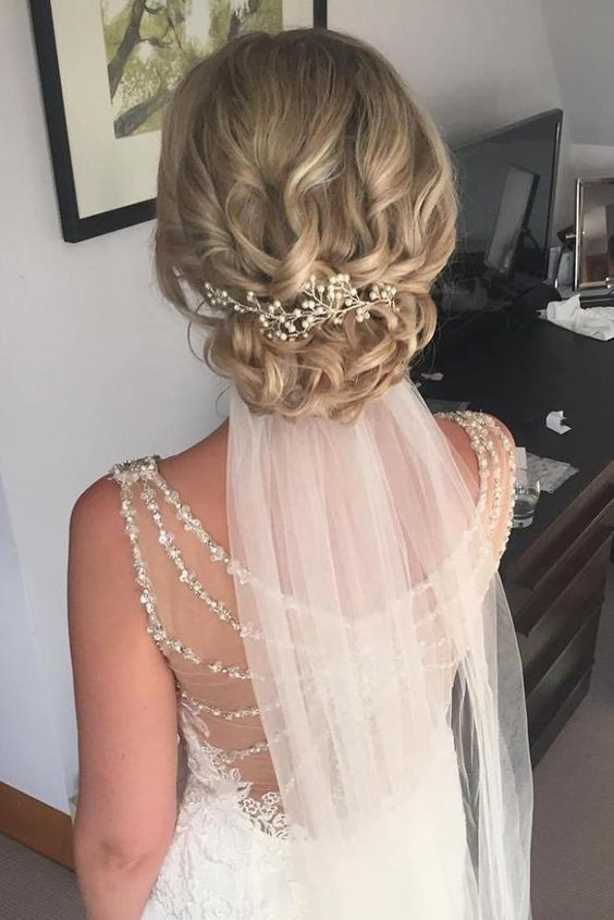 Wedding Hairstyles With Veil On Blonde Bridal Hair With Low Curly