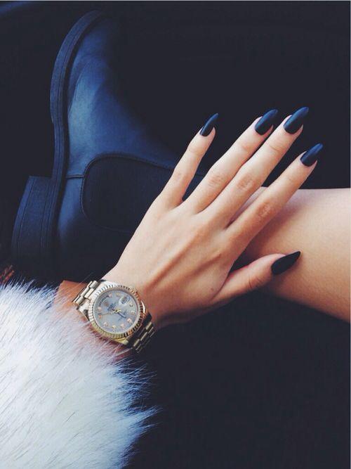 Matt black nails, fur coat and a pretty gold watch.