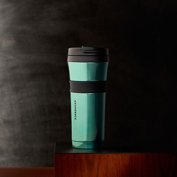 A+double-walled,+stainless+steel+tumbler+with+a+grippy+center+band+and+aqua+finish.