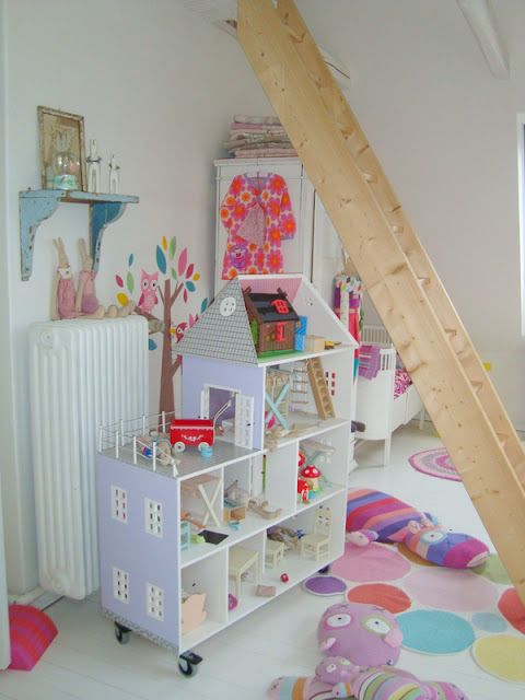 Another Brilliant Dollhouse made out of shelves!  Love the fact it's on wheels, very handy for a large play room.