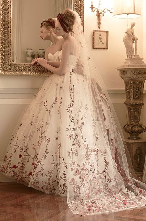 Beautiful red floral embroidery on this tulle ball gown. St. Pucchi, 2014