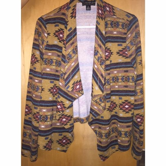 Forever 21 Aztec Cardigan Cute & comfy Aztec sweater. Good condition, rarely worn. Very versatile. Size XL but fits me like a normal cardigan and I wear a small Forever 21 Sweaters Cardigans