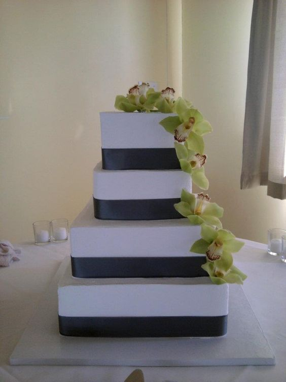 square wedding cakes with ribbon and flowers square wedding cake navy ribbon green cascading flowers 20429