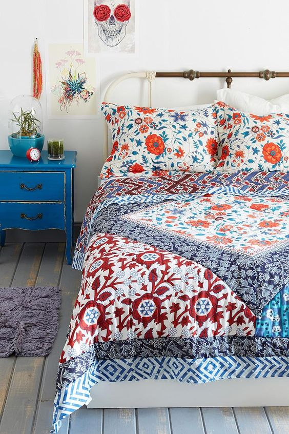 Magical Thinking Farmhouse Floral Quilt #urbanoutfitters. a more modern take on the heirloom style quilt.: