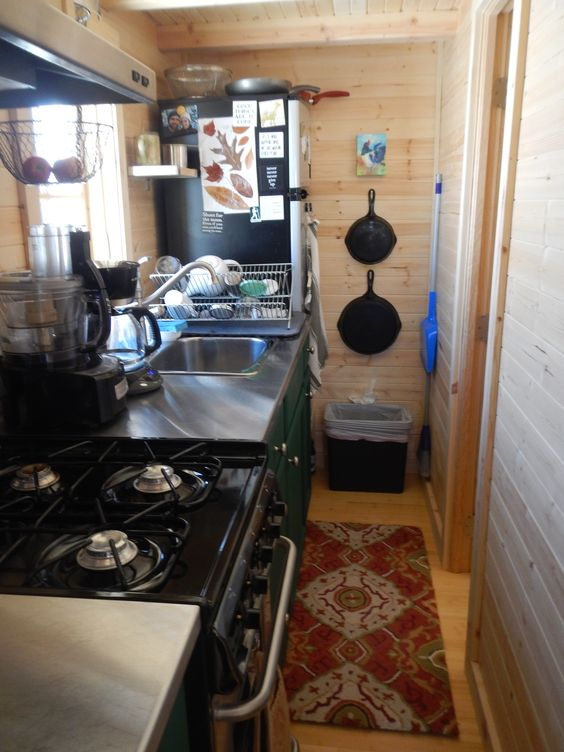 Kitchen - includes 4 burner gas stove, stainless steel counters ...