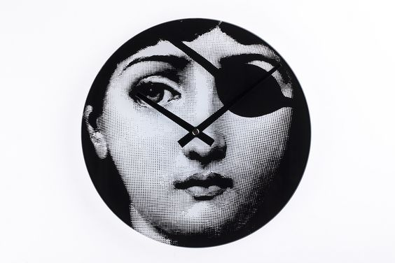 Fornasetti Girl Clock - Hacker Girl - Decorative glass wall clock with eye patch girl print http://www.franceandson.com/girl-clock-hacker-girl.html