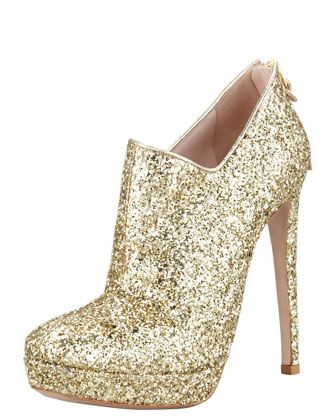 You can never have too much glitter.  Zip-Back Glitter Bootie by Miu Miu at Bergdorf Goodman.