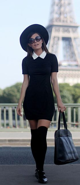 Audrey Leighton Rogers is wearing a black Contrast Collar Dress, Knee High Socks, Hat, Flats and a Weekend Bag all from Boohoo