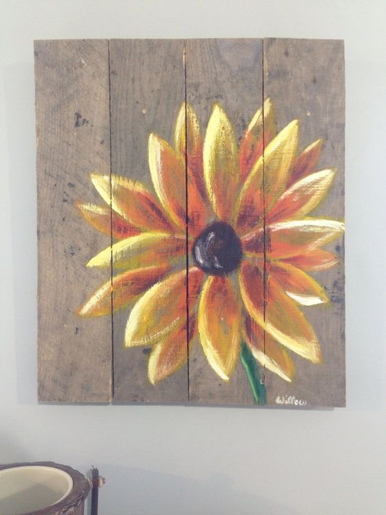 Yellow flower painted with acrylic on reclaimed pallet for Mural on wood