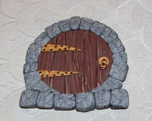 this one was made by Katpac.  I would love a hobbit door inspired by it.