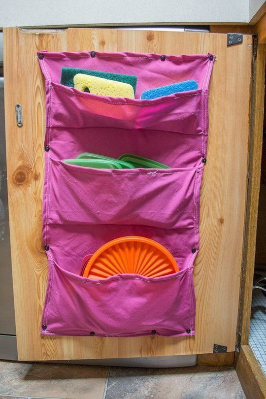 for kitchen storage, make a colorful DIY fabric tupperware lid holder that is fun and functional!
