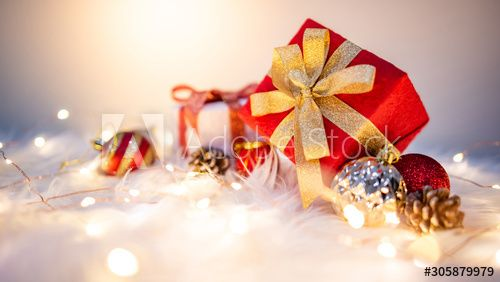 Christmas Decorations 2020 Gifts Lights Christmas decoration on white hairy carpet with illuminated lights