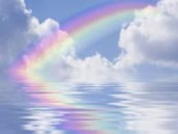 Rainbow with water and clouds
