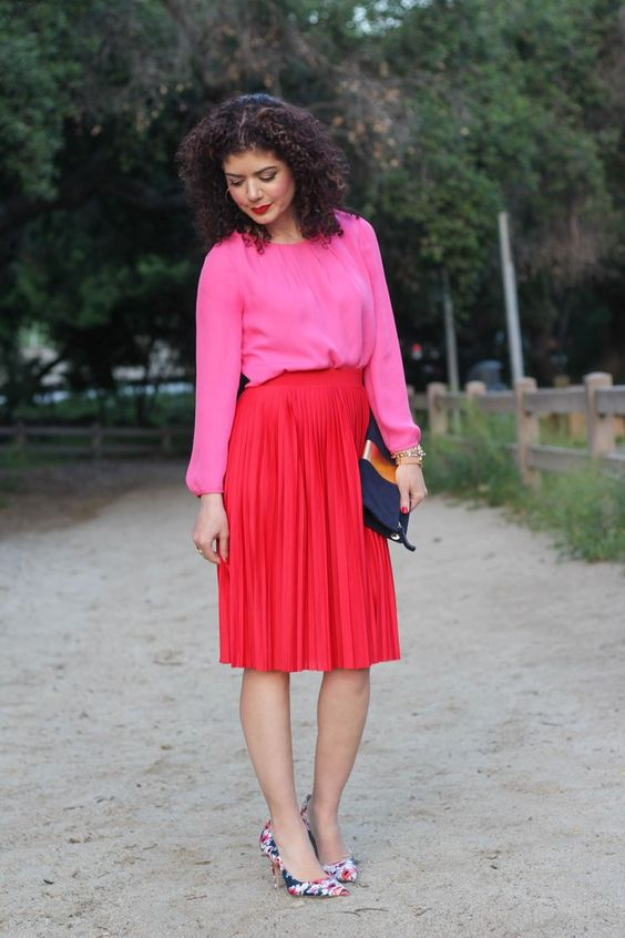 spring 2018 fashion trends   pink and red outfit   color block   red pleated skirt   feminine