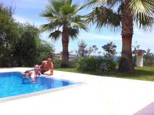 Rafa poolside with his sister.  (via Rafa'sWall Photos on Facebook: https://www.facebook.com/Nadal)