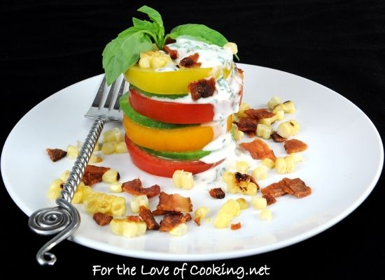 Tomato salad with corn, bacon and avocado.....I would prolly not stack it myself....Just spread it around the plate