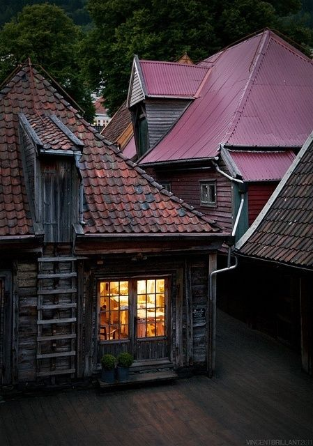 Bryggen, Bergen, Norway. Good food, a fire going steady and the sound of the piano brings to life a quiet night that was slowly fading away into oblivion.
