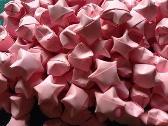 200 pcs of pink lucky stars    Ready to ship    My grandchildren help me a lot in making these bulks. We cut the paper strips and fold them ourselves It