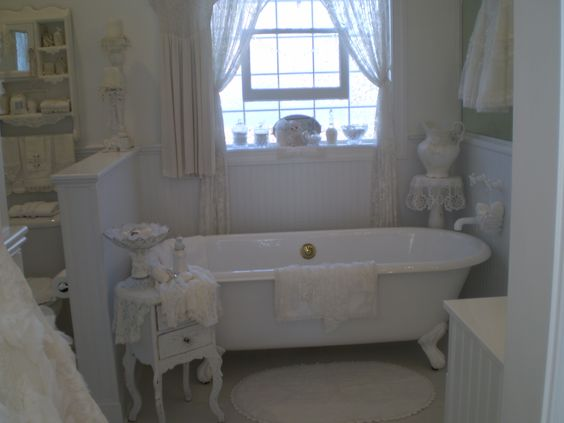 Romantic White Vintage Bathroom with clawfoot tub @Beatrice Banks