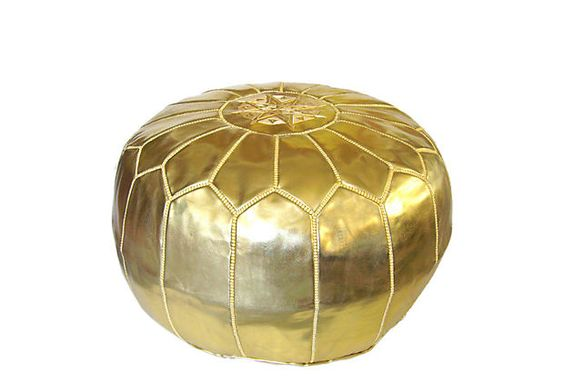 moroccan leather POUF.. gorgeous to use as an ottoman, side table or extra seating. glam.
