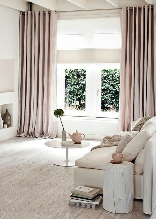 Old rose tinted long modern cashmere (?) curtains with linen roman blind behind