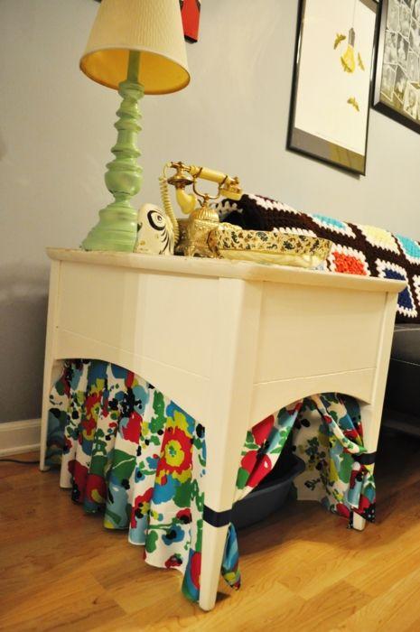 Litter box table!  Cute.