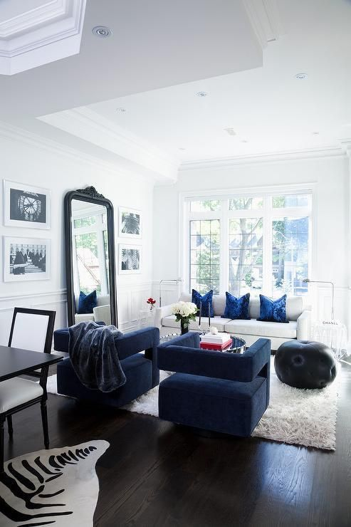 Elegant White And Blue Living Room Boasts Blue Velvet Chairs Placed On A White She Blue Sofas Living Room Modern White Living Room Modern Furniture Living Room