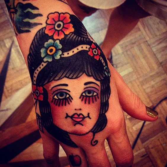 Hand tattoo by Mark Cross