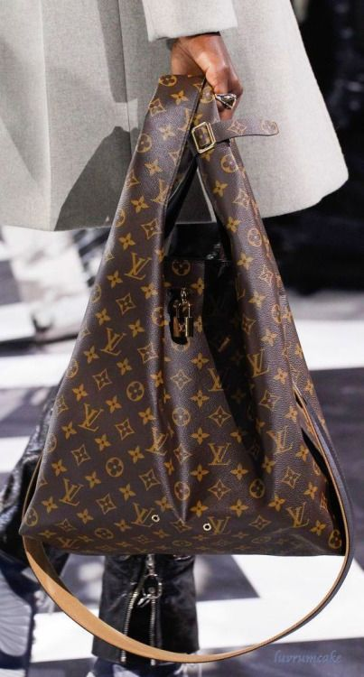 Louis Vuitton.  Not a huge LV bag fan, but this is one cool bag. Love shape.