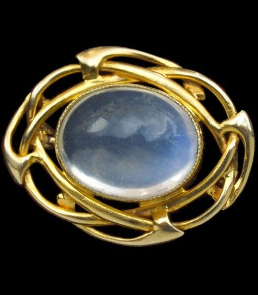A gold and moonstone brooch, by Archibald Knox for Liberty & Co., circa 1900.