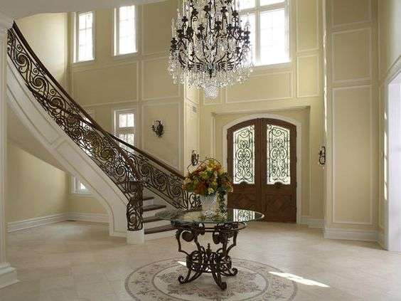 Grand Entry. Limestone floors, handpainted dome rock crystal custom chandelier, and a one-of-a-kind bronze and stone stair. This entry foyer is big enough to hold a decent-size party!