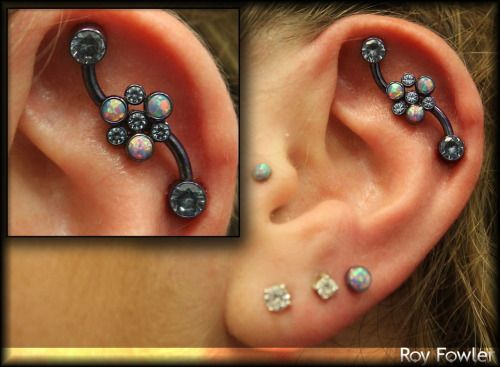 Custom Industrial piercing by Roy Fowler of Studio Seven. Jewelry by Anatometal.