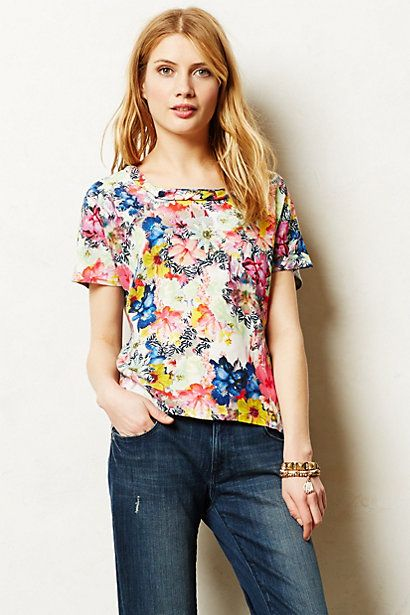 Love the bright colors in the front, and that it is made of a soft gray fabric in the back with a high low hem. Cute!