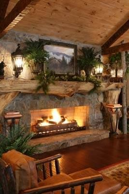 How's this for rustic basement ideas? You get a cabin style basement complete with fireplace and rustic wood furniture to go along with it.