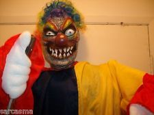 STABBING MOTION KILLER CLOWN. ARM STABS, Gothic carnival music. 70 inches tall.