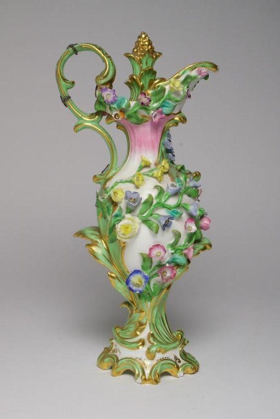 Antique flower encrusted porcelain scent bottle and stopper. Blood Derby ?