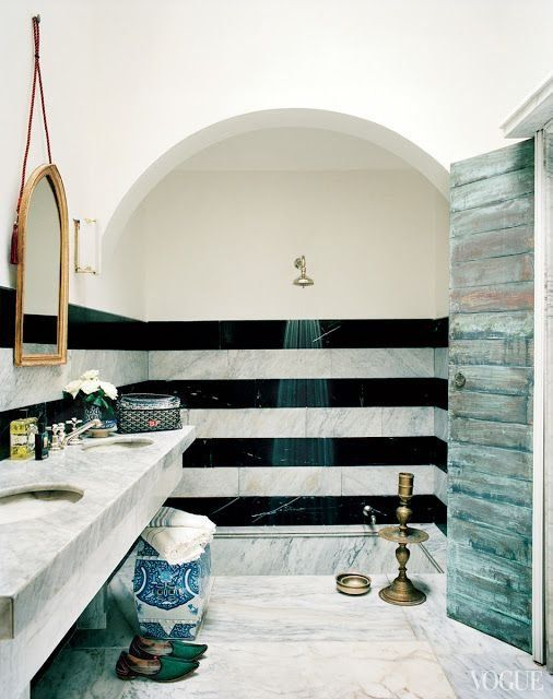 marble moroccan influenced bathroom with open shower. Water deposits on doors and mildewed curtains be gone!