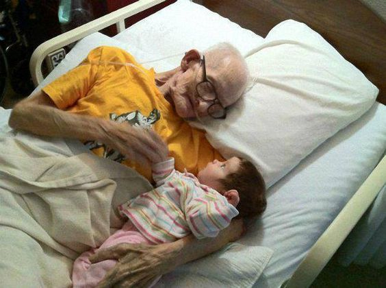 This man lived just long enough to meet and hold his grandbaby before passing away. A beautiful moment.