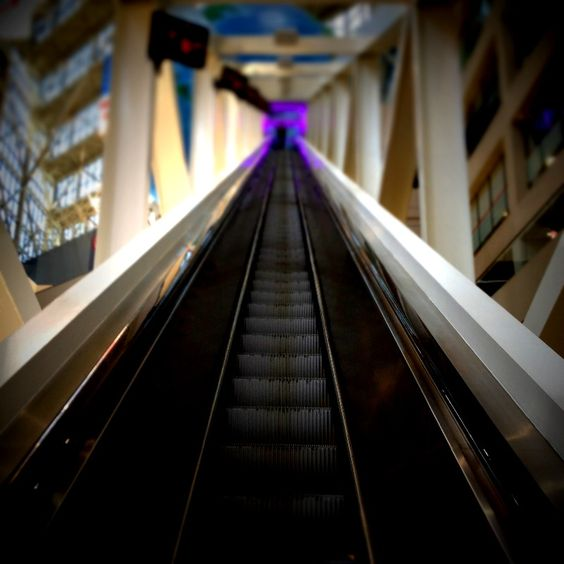escalator at CNN Center. i took the photo myself and it looks real cool. (don't be too impressed I have an app on my iPhone that made it look cool)